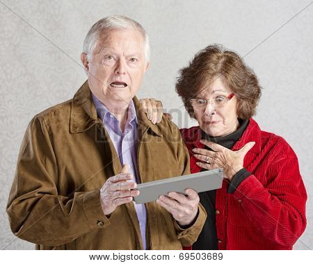 Startled Couple With Tablet