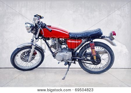vintage color style of old classic motorcycle standing against white background poster