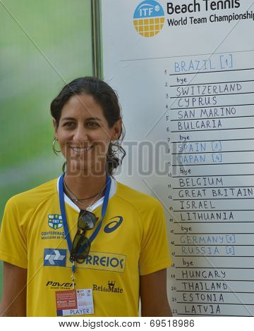 MOSCOW, RUSSIA - JULY 17, 2014: Joana Corez of Brazil against draw board on the Beach Tennis World Team Championship. Cortez is No 1 in the world rankings