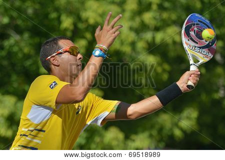MOSCOW, RUSSIA - JULY 19, 2014: Thales Santos of Brazil in the match against Germany during ITF Beach Tennis World Team Championship. Brazil won 2-1