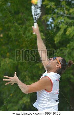 MOSCOW, RUSSIA - JULY 18, 2014: Petros Baghdatis of Cyprus in the match against Brazil during ITF Beach Tennis World Team Championship. Brazil won 3-0