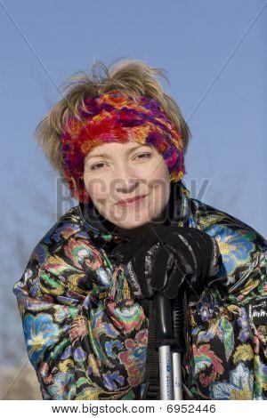 The Young Woman And Ski Sticks