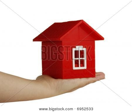Red Toy House On Hand