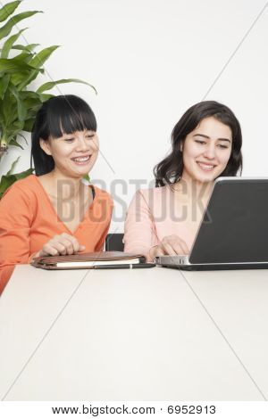 Attractive Young Businesswomen Smiling
