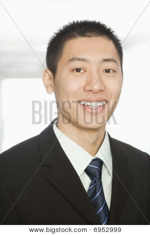 Handsome Young Businessman Smiling