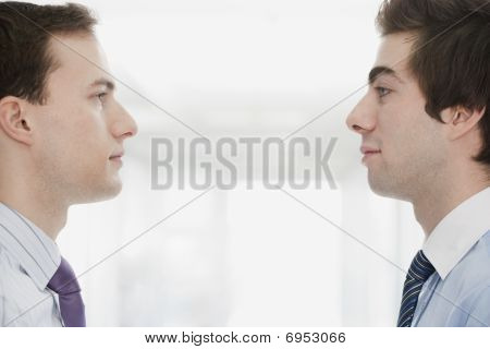 Handsome Young Businessmen Facing Each Other