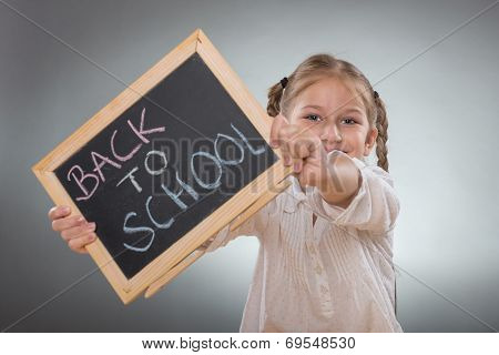 Beautiful little girl holding board on Back To School subtitles