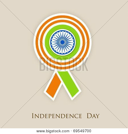 Badge in Indian national colors with Asoka Wheel on beige background for 15th of August, Indian Independence Day celebrations.