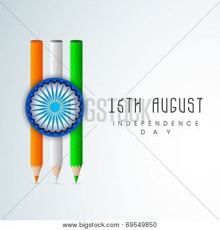 Stylish pencils in national tricolors with Asoka Wheel on grey background for 15th of August, Indian Independence Day celebrations.