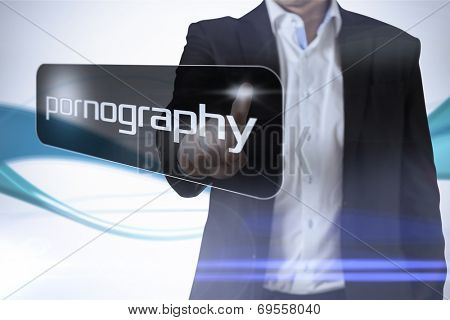 Businessman pointing to word pornography against abstract blue line son white background