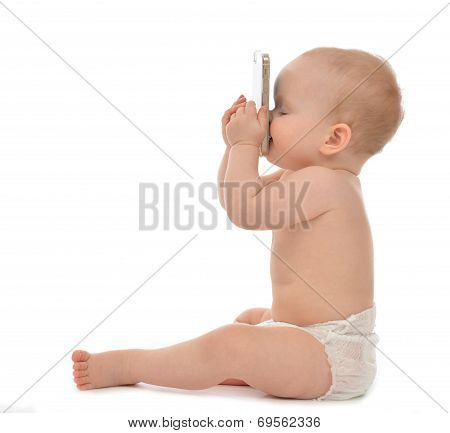 Baby sitting smiling kissing mobile cellphone