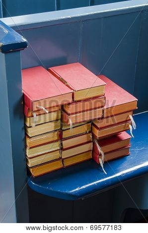 Bibles On A Blue Pew