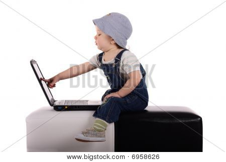 Little Boy With A Laptop