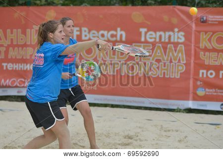 MOSCOW, RUSSIA - JULY 17, 2014: Women's double of Portugal on the training during the ITF Beach Tennis World Team Championship. Russia hosts the championship for the third time