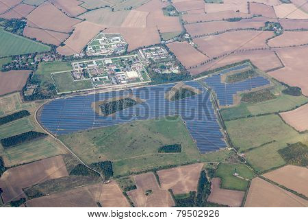Large solar panel array in fields around Highpoint Prison near Newmarket England UK poster