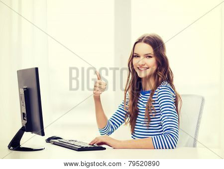 hone, technology and education concept - dreaming teenage girl with computer showing thumbs up at home