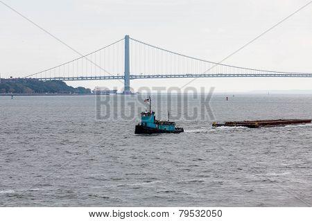 Blue Tugboat And Verrazano Bridge