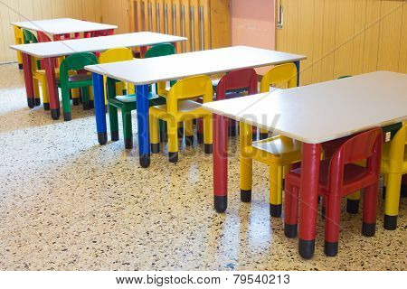 Small Benches And Small Colored Chairs In Preschool