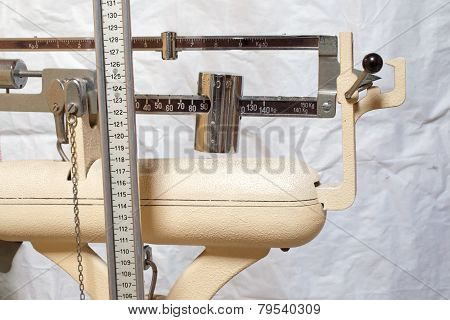 Measuring Rod And Scales To Measure The Children By Pediatrician