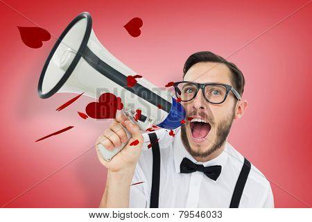 Geeky businessman shouting through megaphone against red vignette