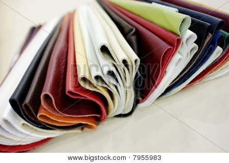 fake leather upholstery material samples in a variety of colors poster