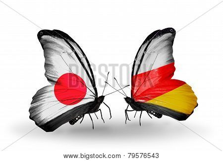 Two butterflies with flags on wings as symbol of relations Japan and South Ossetia poster