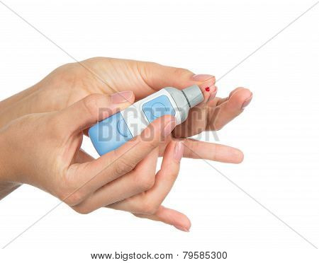 Diabetes lancet in hand prick finger to make punctures to obtain small blood specimens for blood glucose hemoglobin level test using glucometer isolated on a white background poster