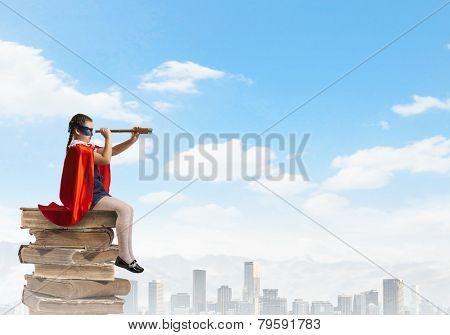Cute girl of school age wearing super hero costume