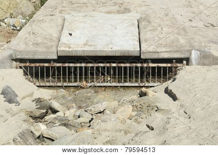 A beach sewer used to drain water runoff from the cliff side during heavy rains to control flooding