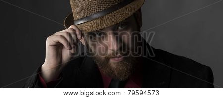 Serious Goatee Man Face with Brown Hat
