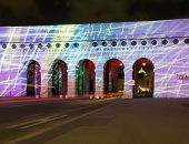 Illumination and light show on the ancient outer castle gate and arches in Heldenplatz Vienna Austria poster
