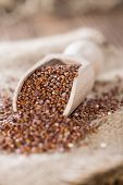 Wooden spoon with red Quinoa (detailed close-up shot) poster