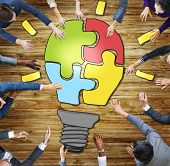 Business People Light Bulb Innovation Jigsaw Togetherness Concepts poster