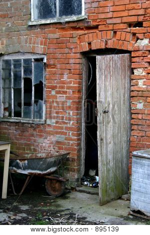 Broken Open Door Of Dereict Building