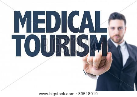 Business man pointing the text: Medical Tourism