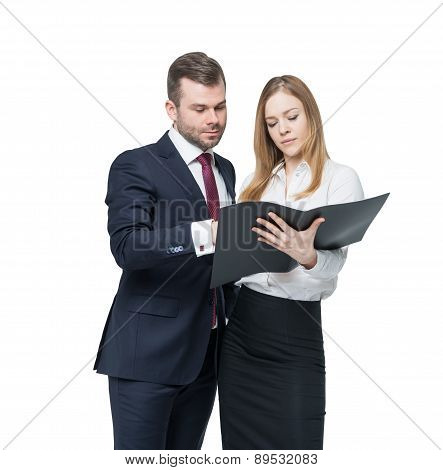 A Young Business Couple Are Looking At The Black Document Case. A Concept Of The Teamwork. Isolated.