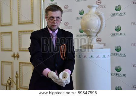 PAVLOVSK, ST. PETERSBURG, RUSSIA - APRIL 29, 2015: Alexey Guzanov, the deputy director of the State Museum-Reserve Pavlovsk with the cap of marble vase during the ceremony of the its return to museum