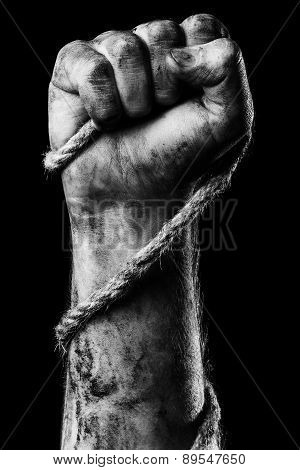 Male hand with rope on black background. Conception aggression poster