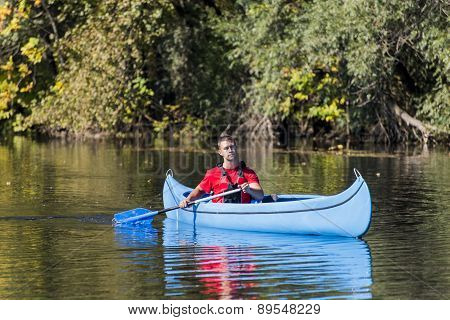Young Man In Canoe