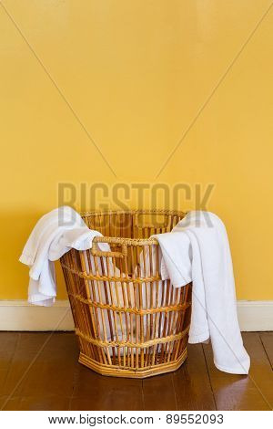 White Used Towels In Wicker Basket