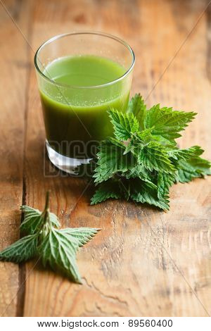 Nettle leaves and glass of nettle juice