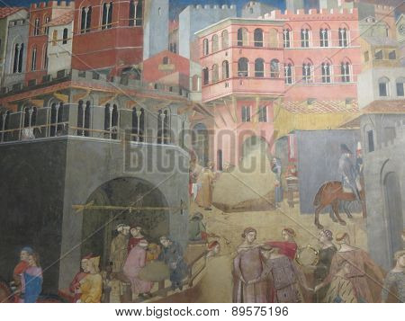 SIENA ITALY - CIRCA DECEMBER 2014 - Ambrogio Lorenzetti 1285-1348 Allegory of the Good Government: Effects of Good Government on the City Life 1338-1340 Siena Public Palace Central detail Renaissance art