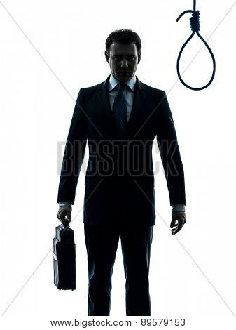 one  businessman standing in front of hangman's noose in silhouette studio isolated on white background