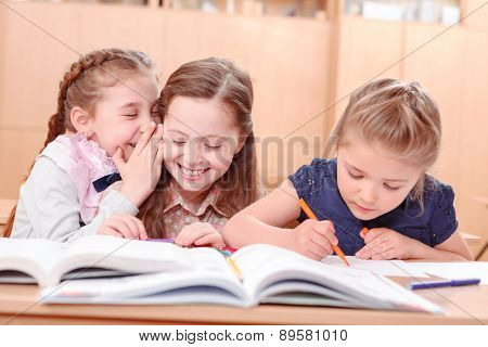 Girls with opened books in classroom