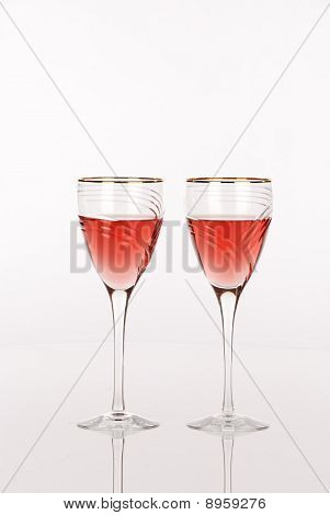 Two Luxury Wine Glasses With White Zinfandel Wine