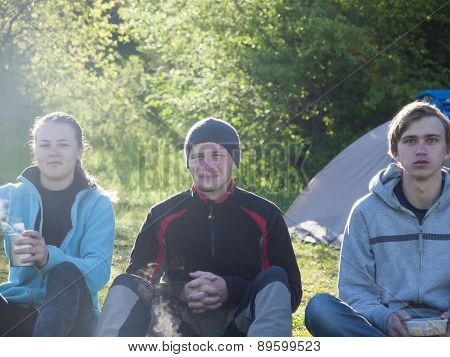 Young People Have Breakfast Outdoors.
