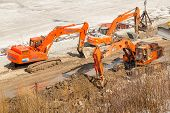 Tyumen, Russia - March 29, 2008: Excavators on pedestrian quay construction on Tura river poster