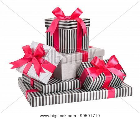 Grey And Striped Boxes With Pink Bows Isolated