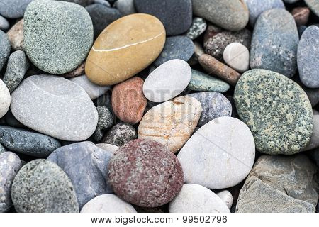 Pebble background texture with many pebbles of different sizes and shapes from Batumi Beach, Georgia