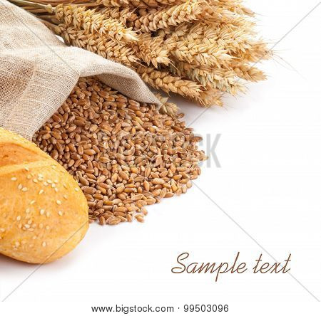 Wheat In A Sack, Ears And Bread On A White Background